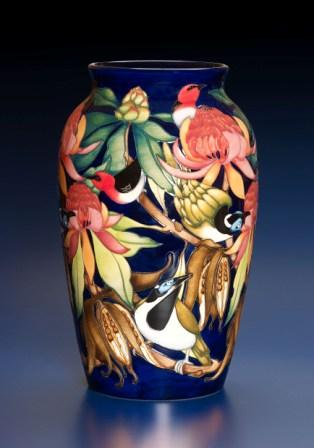 Australian Moorcroft Collection available only in with an exclusive Australian Map back-stamp on each piece made until 31st December, 2007. Numbered edition The Black Cockatoo, Kulan, Calgaroo, Black Bean, Banksia. The main designer of this collection Philip Gibson.  For 2008 there are 2 new additions to the collection - 1 a 576/9 with the Australian Koala nestled in the branches of a flowering gum tree and the other a 402/4 Uluru encircled by a goanna and the sides covered in the native desert pea flower.